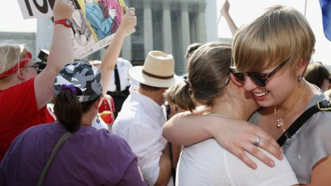 American University students Sharon Burk, left, and Molly Wagner embrace outside the Supreme Court.