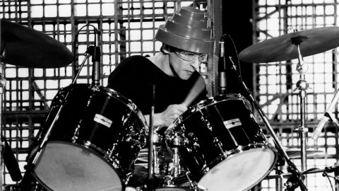 """Alan Myers, Devo's most well-known drummer, <a href=""""http://clubdevo.com/index.php?option=com_k2&view=item&id=4689:devo-mourns-passing-of-alan-myers&Itemid=27"""" target=""""_blank"""" target=""""_blank"""">lost his battle with cancer</a> on June 24. Band member Mark Mothersbaugh said in a statement that Myers' style on the drums helped define the band's early sound."""