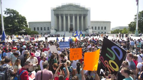 A crowd of people outside the Supreme Court in Washington react to the rulings.