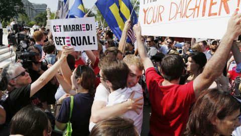 People in the crowd embrace outside the Supreme Court in Washington.