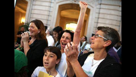 Sue Rochman, center, and Robin Romdalvik celebrate with their son, Maddox Rochman-Romdalvik, at City Hall in San Francisco.