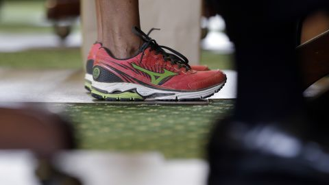 In preparation for hours of speaking, Davis wore a pair of pink sneakers in place of her dress shoes. Her shoes became a symbol for abortion-rights activists.