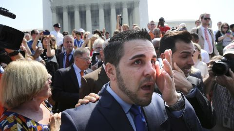 """Jeff Zarrillo, center, and Paul Katami, right, plaintiffs in the California case against Proposition 8, wipe away tears after departing the Supreme Court in Washington. <a href=""""http://www.cnn.com/video/?/video/politics/2013/06/26/sot-dc-scotus-prop-8-proposal-katami-zarrillo.cnn"""">Katami proposed to Zarrillo</a> on national news after the ruling."""