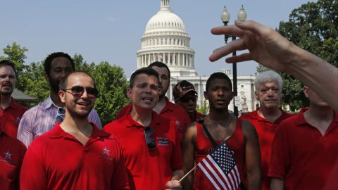 With the Capitol in the background, the Gay Men's Choir of Washington performs outside of the Supreme Court in Washington.