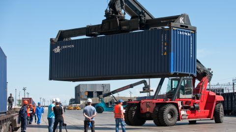 Due to a change in track gauge from 'normal' (or 1435mm) in China to 'wide' (or 1520mm) in Kazakhstan, the cargo containers must be transferred to new rolling stock.