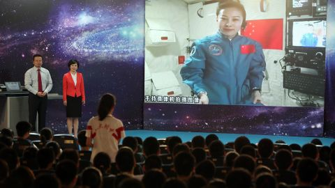 A girl in a school in Beijing asks Chinese female astrounaut Wang Yaping questions as Wang delivers a lesson to students from Tiangong-1 space module on June 20, 2013.