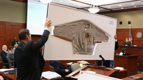 """Assistant state attorneys John Guy, left, and Richard Mantei hold up Martin's sweatshirt as evidence during Zimmerman's trial on June 25. After Martin's death, <a href=""""http://www.cnn.com/2012/03/27/living/history-hoodie-trayvon-martin/index.html"""">protesters started wearing hoodies</a> in solidarity against racial profiling."""