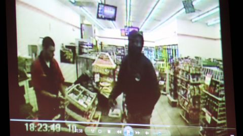 A video entered as evidence is displayed on June 24. It shows  Martin, right, at a 7-Eleven on the night of his shooting.