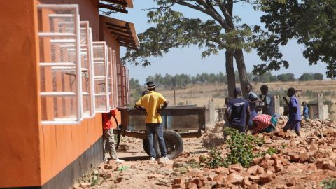 The community in Matau has helped rebuild the school, molding nearly 400,000 bricks for the new building.