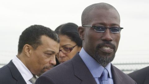 """<a href=""""http://www.cnn.com/2013/04/05/showbiz/wesley-snipes-released"""" target=""""_blank"""">Wesley Snipes</a> was helped by Smith, seen here in the background, during his tax fraud problems in 2006."""
