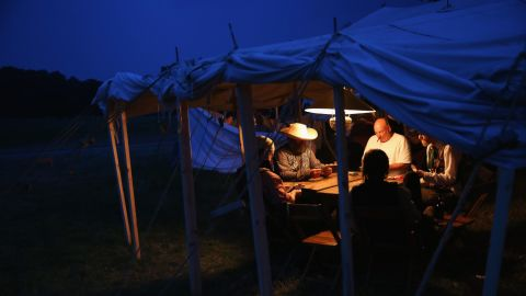 Reenactors play poker while on break during the three-day event on June 29.