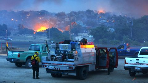A wildfire burns homes near Yarnell on June 30.