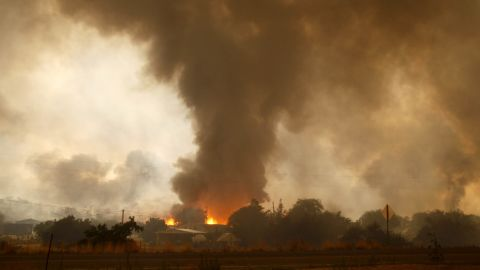 A wildfire destroys homes in the Glenn Ilah area near Yarnell on June 30.