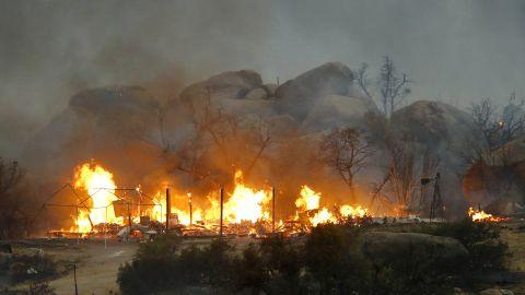 Homes burn on Sunday, June 30, in Glenn Ilah, Arizona, near Yarnell.
