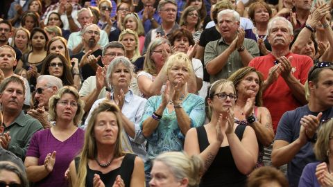 Members of the community give a standing ovation as local firefighters arrive at the July 1 memorial service at Embry-Riddle Aeronautical University in Prescott.