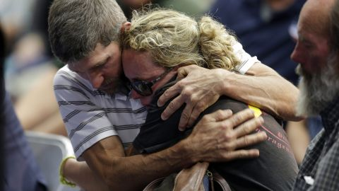 """A couple embraces during the Prescott memorial service for the fallen fighters on July 1. <a href=""""http://www.cnn.com/2013/07/02/us/gallery/hot-shot-victims/index.html"""">The elite team members' deaths</a> on Sunday, June 30, marked the deadliest day for firefighters since the 9/11 attacks."""