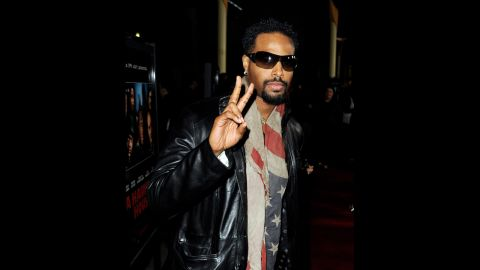 """Shawn Wayans tucks his stars and stripes around his neck for the premiere of brother Marlon Wayans' movie, """"A Haunted House,"""" in Los Angeles."""