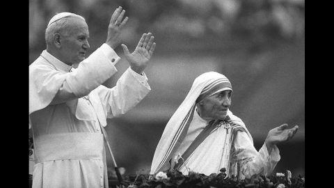 Pope John Paul II and Mother Teresa wave to well-wishers in Kolkata, India, in February 1986.