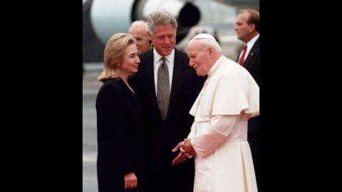 Bill and Hillary Clinton greet Pope John Paul II as he arrives in Newark, New Jersey, on a U.S. trip in October 1995.