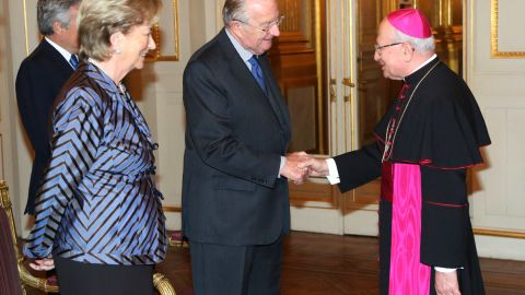 King Albert II shakes hands with Giacinto Berloco, the Vatican's prelate to Belgium and Luxembourg, while he and Queen Paola attend a reception at the Palais de Bruxelles on January 9 in Brussels.