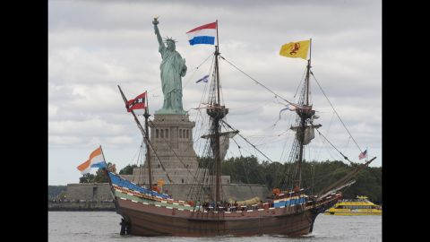 A replica of the Dutch ship Half Moon sails past the Statue of Liberty in September 2009, commemorating Henry Hudson's entry into New York Harbor in 1609.