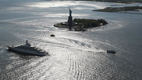Boats pass the statue in May 2013. It had been closed more than six months following Superstorm Sandy.