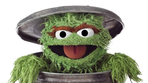 """A bad-tempered green monster who loves """"anything dirty or dingy or dusty"""" and lives in a trash can: perhaps not an obvious choice for a children's TV hero. Yet <strong>Oscar the Grouch</strong>, whose ambition is to be as miserable as possible, has failed to ruin viewers moods, bringing humor and fun to the Street."""