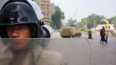 An Egyptian military member guards a roadblock in Giza on July 4.