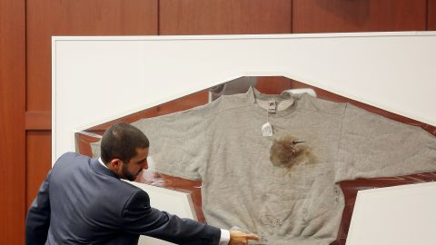 Florida Department of Law Enforcement Crime Lab Analyst  Anthony Gorgone testifies about DNA findings on Wednesday, July 3, in Sanford, Florida. Here, Gorgone points to a sweatshirt worn by Trayvon Martin on the night Martin was shot. Only one stain on Martin's hooded jacket yielded a partial DNA profile that matched Zimmerman's.