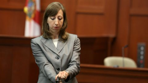 Firearms analyst Amy Siewert from the Florida Department of Law Enforcement answers questions from the prosecution while holding Zimmerman's gun on July 3. Siewert examined the gun and said Zimmerman had one bullet ready to fire in the chamber as well as a fully loaded magazine when the shooting occurred.