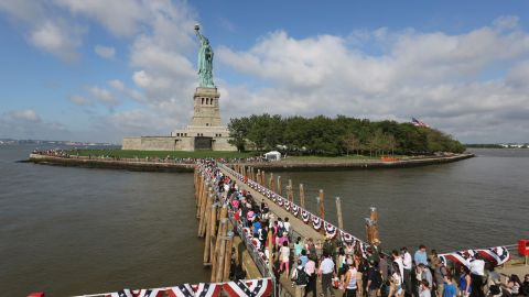 Visitors disembark from a ferry in July 2013. It was the first day the attraction reopened after suffering damage from Superstorm Sandy.