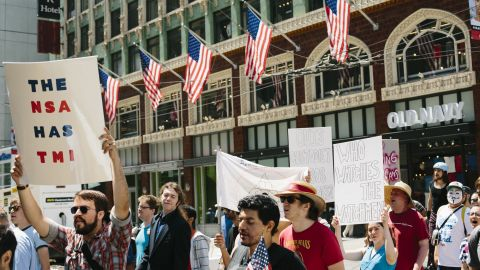 """""""Restore the Fourth"""" protesters in San Francisco on Thursday call for an end to government surveillance programs."""