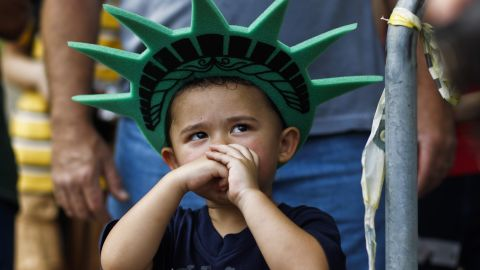 """A child attends a ceremony to reopen the <a href=""""http://www.cnn.com/2013/07/03/us/gallery/statue-of-liberty/index.html"""">Statue of Liberty</a> to the public in New York on July 4."""