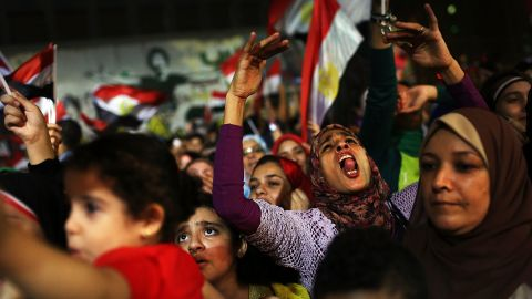 People dance and cheer in the streets of Cairo on July 4.