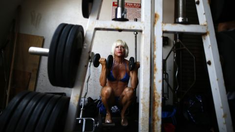 A woman warms up at the Muscle Beach Independence Day bodybuilding contest in Los Angeles.