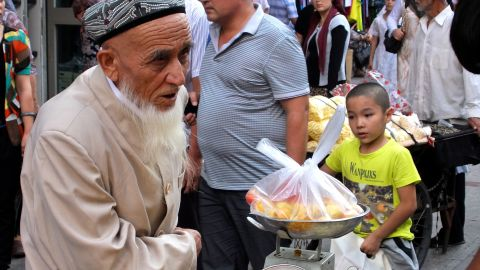 Uyghurs are very distinctive from Han Chinese -- they have their own language, food, religion and customs.