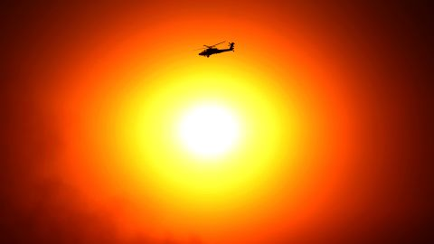 A military helicopter flies by Egypt's Presidential Palace in Cairo on July 5.