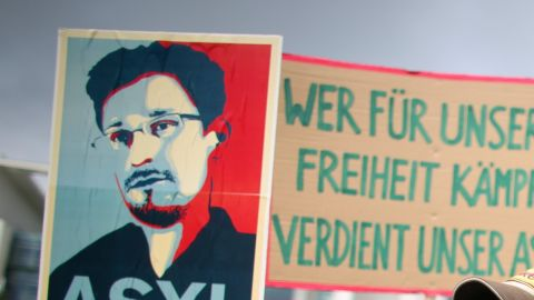 Activists demonstrate on July 4 in front of the German Chancellery in Berlin in support of granting U.S. intelligence leaker Edward Snowden asylum.