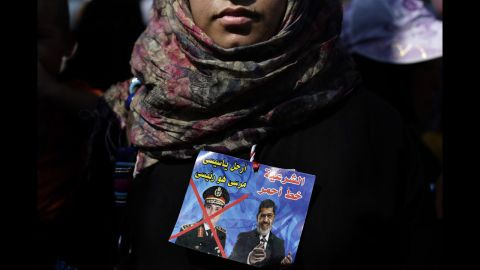 A Morsy supporter joins protests near the University of Cairo in Giza on July 6.