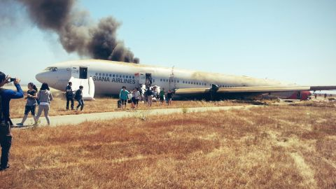 """David Eun, a passenger on Asiana Airlines Flight 214, posted this image to Path.com along with the message, """"I just crash landed at SFO. Tail ripped off. Most everyone seems fine, I'm ok. Surreal..."""" It was one of the first photographs taken after the crash."""