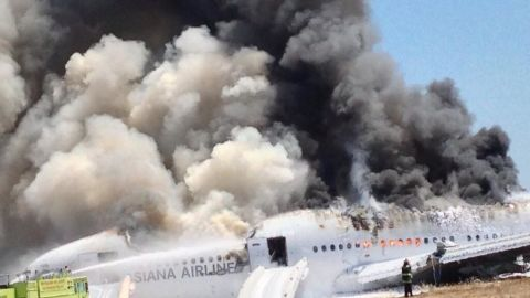 A photo provided to CNN by Eunice Bird Rah -- and shot by her father, who was a passenger on the plane -- shows flames and smoke bursting out of many of the aircraft's windows.
