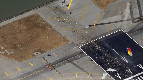 Debris litters the runway on July 6.