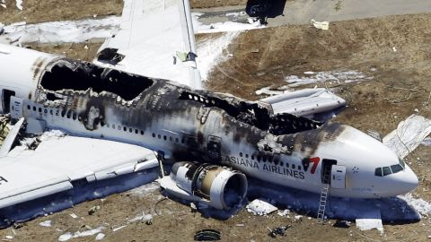 Asiana Airlines Flight 214 remains on the runway on July 6.
