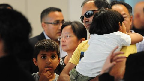 People are escorted from the Reflection Room at the San Francisco International Airport on July 6.
