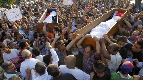 People carry coffins on July 6 of two Morsy opponents who were killed during clashes in Cairo.