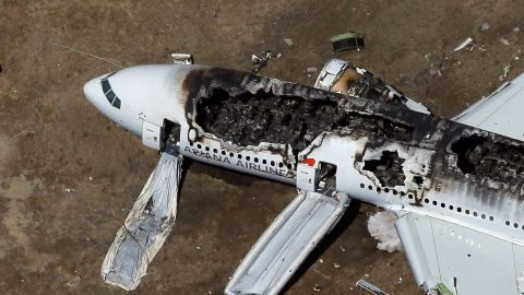 A Boeing 777 airplane lies burned near the runway after it crash-landed at San Francisco International Airport July 6, 2013 in San Francisco, California. An Asiana Airlines passenger aircraft coming from Seoul, South Korea crashed while landing, killing two people and injuring scores of others.