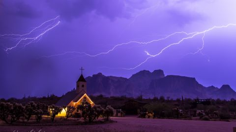 """Storm chaser <a href=""""http://ireport.cnn.com/docs/DOC-1001516"""">Stacy LeClair</a> got this shot during a severe storm that swept through Apache Junction, Arizona, on July 7. """"The Superstition Mountains are a favorite landmark in Arizona, and the church offered a unique background for showing how powerful nature can be,"""" she said."""