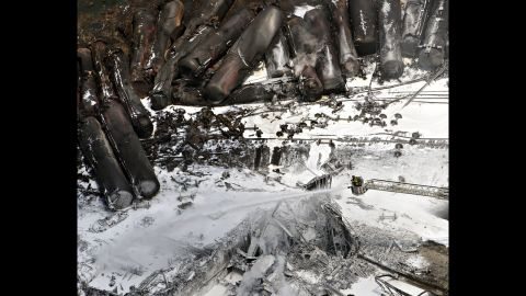 Firefighters continue to water smoldering rubble on July 7.