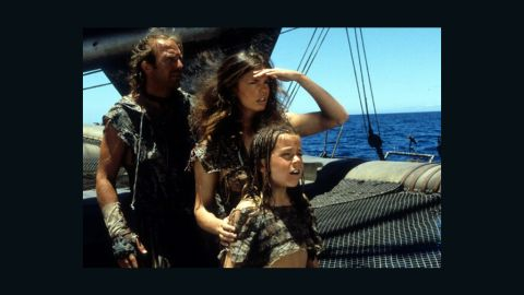 """<strong>""""Waterworld"""" (1995):</strong> Kevin Costner got a lot of flak for this film, in its day the most costly of all time. Nicknamed """"Kevin's Gate,"""" the film got more attention for its budget than its action -- which, finally, wasn't bad. It even did decently at the box office. But try telling that to people now. Jeanne Tripplehorn, center, and Tina Majorino co-starred with Costner."""