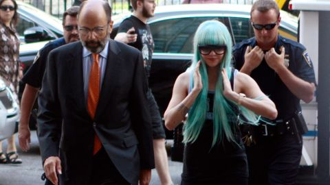 """Bynes and attorney Gerald Shargel arrive for a court appearance in New York on July 9, 2013. She was charged with reckless endangerment and attempting to tamper with physical evidence. <a href=""""http://miami.cbslocal.com/2014/06/30/amanda-bynes-new-york-bong-tossing-case-dismissed/"""" target=""""_blank"""" target=""""_blank"""">The case was later dismissed. </a>"""